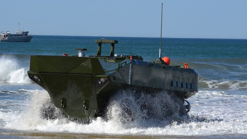 A major priority for the Marines is its Amphibious Combat Vehicle (ACV) which has equivalent water capabilities to the AAV with better survivability and ground mobility.  The BAE Systems/Iveco SuperAV, recently selected, will allow an infantry squad to keep up with Marine M1A1 MBTs and to operate on the envisioned manoeuvre battlefield.  Here a SuperAV launches from the stern ramp of an amphibious ship. (Photo: USMC)