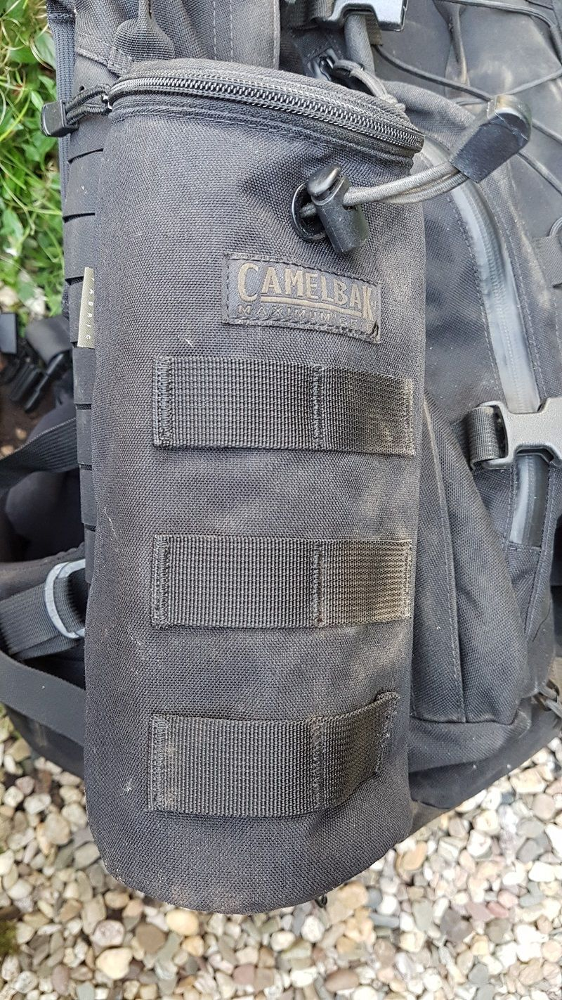 Camelbak's Max Gear Bottle Pouch is a light (153g/5.4oz) and softer, yet super strong bottle holder made out of 500D Cordura. It attaches to any MOLLE attachment system and has MOLLE webbing on the front for additional gear. The zipper and compression bungee both operate smoothly, while the 500D Cordura and nylon webbing insulate any .75l or 1l CamelBak bottle inside the pouch.