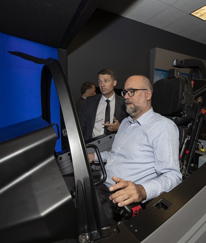 Editorial Director being given the rundown of Sensor Fusion on Lockheed Martin's F-35 simulator. (Photo: LM)