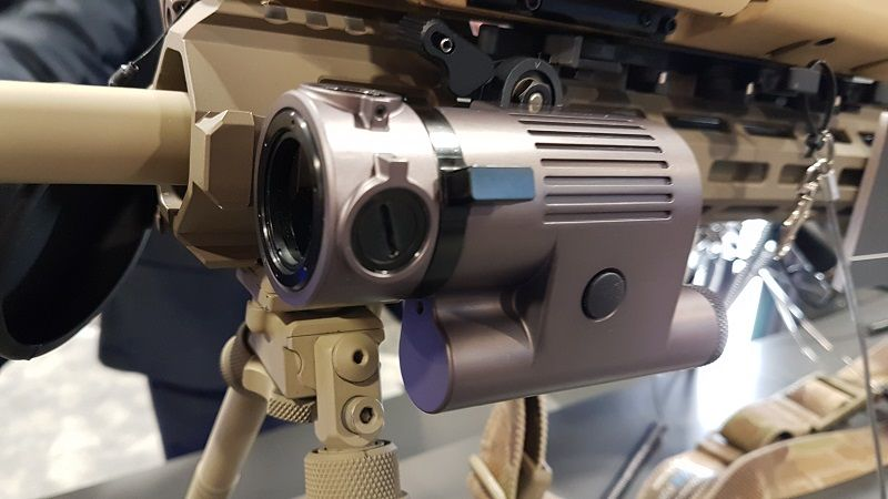 """At AUSA 2018, FLIR Systems showcased it new SABER-NIR illuminator, which is being properly launched at SHOT Show 2019. SABER-NIR provides high-power, near-infrared (NIR) illumination for use with night vision and image intensified (I2) imagers. The vertical-cavity surface-emitting (VCSEL) array laser source provides unsurpassed beam uniformity for what the company calls the, """"ultimate capability in feature resolution."""" Small and lightweight at 320g with batteries, measuring 4.59x2.5x1.57in, the unit can be rifle-mounted or handheld. SABER-NIR features 50mW of NIR illumination, variable beam divergence to match any application, speckle-free, extremely uniform beam profile, 860nm wavelength for use with all night vision goggles and I2 tools, minimises SWaP (see above), self-contained battery and controls, remote tapeswitch option for fire button and azimuth and elevation adjustments. The optical output power is selectable, up to 500mW, and the beam divergence is adjustable, 2-8 degrees, with laser safety class"""
