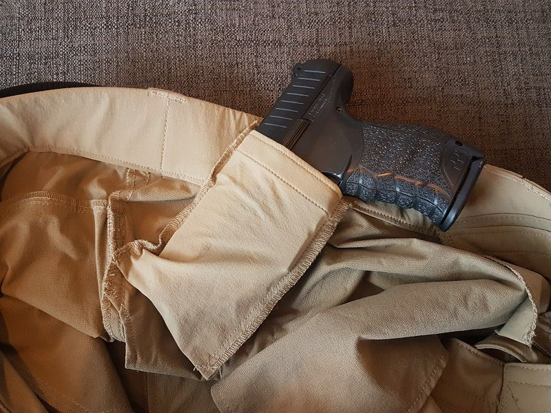 Four pockets are sewn inside that can hold gear; two smaller in the front and two magazine sized pockets on each side. These may also improvise as inside the waistband (IWB) holster for concealed carry of pistols.