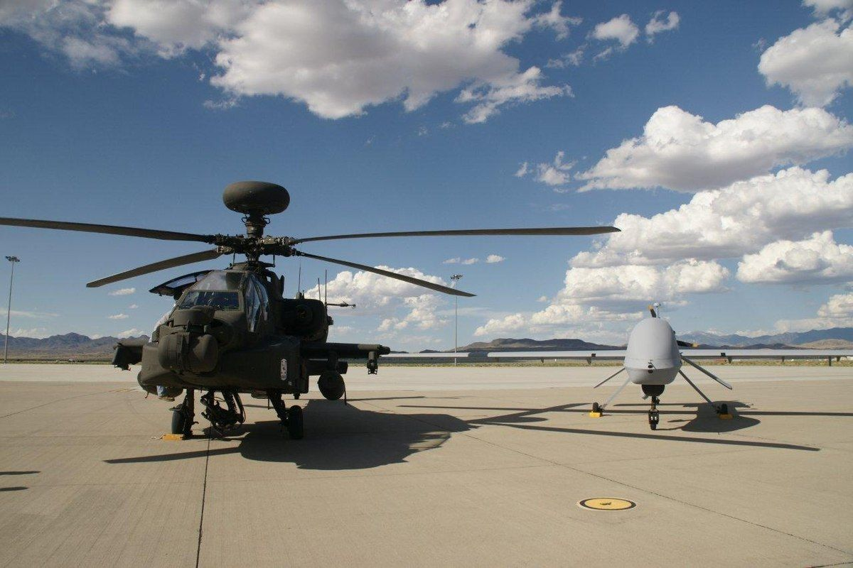 An aerial version of MUM-T has been tested with success in recent combat in Iraq and Syria. AH-64E APACHEs have integrated both the Textron RQ-7 SHADOW and General Atomics MQ-1C GRAY EAGLE (shown) in order to be able to transmit and receive real-time streaming video and to control the UAS to engage targets far forward of the helicopter. (Photo via author)
